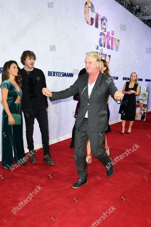 Stock Picture of German director Detlev Buck (C) runs at the red carpet of the Bertelsmann party 2019 in Berlin, Germany, 12 September 2019. More than 600 guests from all fields of society are invited for the Bertelsmann Party 2019.