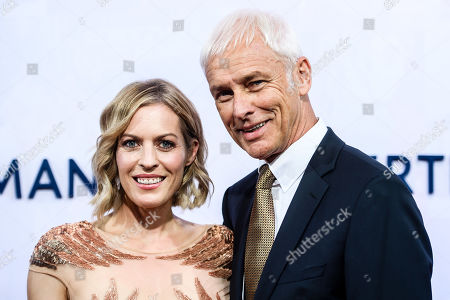 Stock Photo of Former automotive group Volkswagen (VW) CEO Matthias Mueller (R) and his partner, German TV presenter Jule Goelsdorf, attend the red carpet of the Bertelsmann party 2019 in Berlin, Germany, 12 September 2019. More than 600 guests from all fields of society are invited for the Bertelsmann Party 2019.