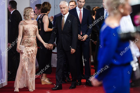 Former automotive group Volkswagen (VW) CEO Matthias Mueller (2-L) and his partner, German TV presenter Jule Goelsdorf (L), attend the red carpet of the Bertelsmann party 2019 in Berlin, Germany, 12 September 2019. More than 600 guests from all fields of society are invited for the Bertelsmann Party 2019.