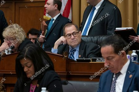 House Judiciary Committee Chairman Jerrold Nadler, D-N.Y., center, leads his panel to approve guidelines for impeachment investigation hearings on President Donald Trump, on Capitol Hill in Washington