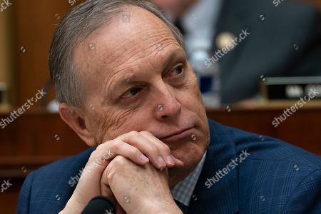 Rep. Andy Biggs, R-Ariz., the newly-elected chairman of the conservative House Freedom Caucus, listens as House Judiciary Committee Chairman Jerrold Nadler, D-N.Y., leads his panel to approve guidelines for impeachment investigation hearings on President Donald Trump, on Capitol Hill in Washington