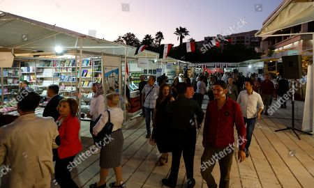 People take part at the international Book Fair at al-Assad National Library in Damascus, Syria, 12 August 2019. The fair was opened under the patronage of President Bashar al-Assad?s vice-President Najah al-Attar. Dozens of publishing houses from Lebanon, Iraq, Egypt, Saudi-Arabia, Palatine, Jordan, Iran, Denmark and Russia are taking part in the 10-day fair.