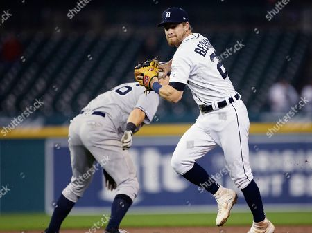 Stock Picture of Detroit Tigers' Gordon Beckham, right, throws to first for a double play against New York Yankees' Aaron Judge after tagging out Yankees' DJ LeMahieu, left, during the ninth inning of the second game of a baseball doubleheader, in Detroit