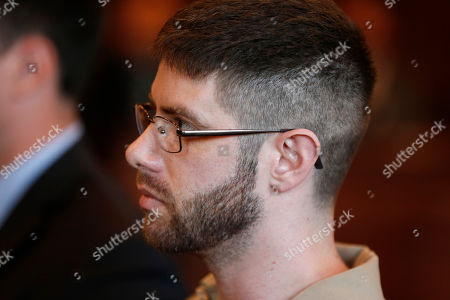John Williams listens as he is sentenced for the April 25, 2018 killing of Somerset County Cpl. Eugene Cole, in Portland, Maine. Williams was sentenced to life in prison