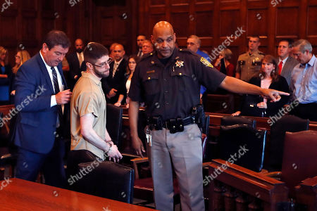John Williams is led from the courtroom in Portland, Maine, after being given a life sentence for the April 25, 2018 killing of Somerset County Cpl. Eugene Cole