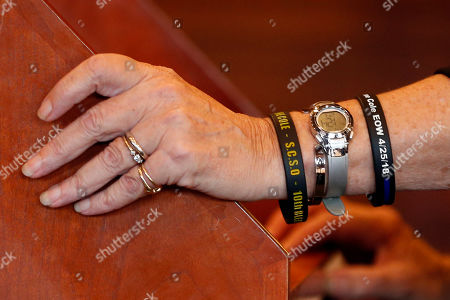 Sheryl Cole, the wife of slain Cpl. Eugene Cole, wears bracelets honoring her husband, during the sentencing hearing of John Williams, in Portland, Maine. Williams was given a life sentence for the April 25, 2018 killing of Sheriff Cole