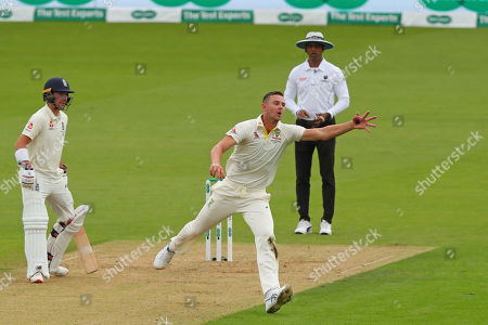 Stock Picture of LONDON, ENGLAND. 12 SEPTEMBER Josh Hazlewood of Australia fields the ball off his own bowling during day one of the 5th Specsavers Ashes Test Match, at The Kia Oval Cricket Ground, London, England