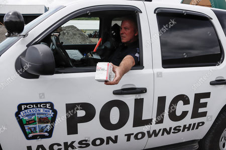 Jackson Township Police Sergeant Tim Amrhein shows a box of Narcan, a drug used to treat opioid overdose, that was deployed to one of the safety officers at one of the nearby Seneca Valley Schools, in Jackson Township, Butler County, Pa. The drug has an expiration date and is being replaced