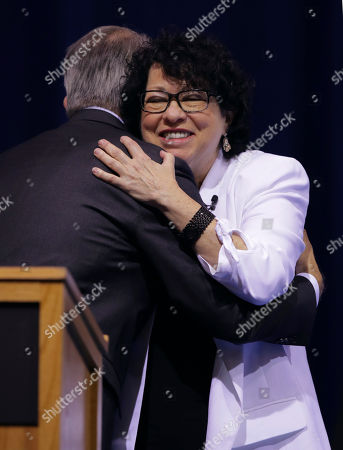 Stock Picture of U.S. Supreme Court Justice Judge Sonia Sotomayor, right, embraces Tufts University President Anthony Monaco, during a visit to Tufts University in Medford, Mass