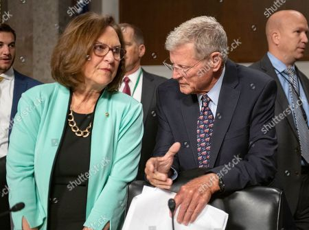 United States Senator Deb Fischer (Republican of Nebraska), left, and US Senator Jim Inhofe (Republican of Oklahoma), chairman, US Senate Committee on Armed Services, right, converse prior to hearing testimony before the committee from Ryan D. McCarthy on his nomination to be Secretary of the Army and Barbara M. Barrett on her nomination to be Secretary of the Air Force.