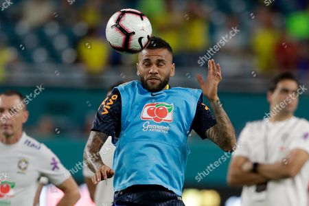 Brazil defender Daniel Alves warms up before a friendly soccer match against Colombia, in Miami Gardens, Fla