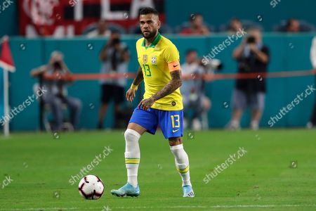 Stock Picture of Brazil defender Daniel Alves (13) moves the ball during the first half of a friendly soccer match against Colombia, in Miami Gardens, Fla