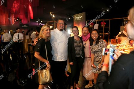 Vice President of Culinary at Patina Catering Gregg Wiele, second from left, poses for a photo with some members of the press at the 71st Governors Ball press preview, in Los Angeles