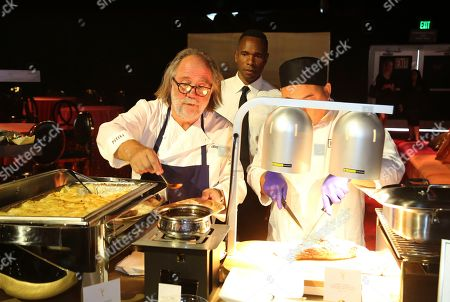 This photo shows Chef Joachim Splichal of Patina Catering, left, working on one of his menu items during the 71st Governors Ball press preview, in Los Angeles