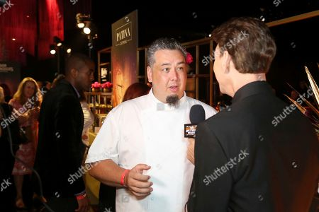 Stock Image of Vice President of Culinary at Patina Catering Gregg Wiele is interviewed at the 71st Governors Ball press preview, in Los Angeles