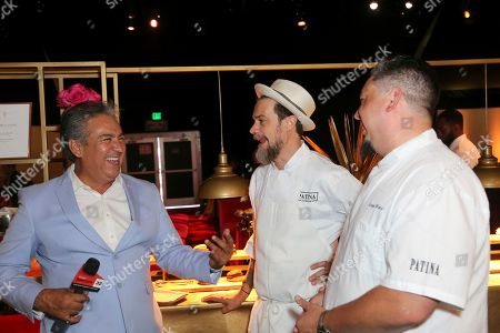Vice President of Culinary at Patina Catering Gregg Wiele, right, is interviewed at the 71st Governors Ball press preview, in Los Angeles