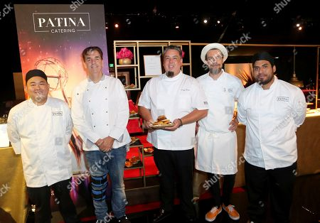 Executive Chef at Patina Catering Alec Lestr, second from left, Vice President of Culinary at Patina Catering Gregg Wiele and some members of their team pose for a photo at the 71st Governors Ball press preview, in Los Angeles