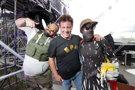The DJ and Festival producer Joachim Garraud and guests pose on stage during the 10th anniversary of the Electric Park Festival