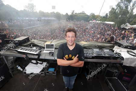 The DJ and Festival producer Joachim Garraud poses on stage during the 10th anniversary of the Electric Park Festival