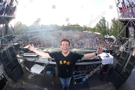 Stock Photo of The DJ and Festival producer Joachim Garraud poses on stage during the 10th anniversary of the Electric Park Festival