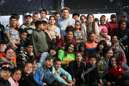 Former Uruguayan soccer player Diego Forlan (C) poses accompanied by children during the celebration of the 30th anniversary of the NGO Gurises Unidos in Montevideo, Uruguay, 12 September 2019. Gurises Unidos was founded to protect the rights of disadvantaged children in Uruguay.