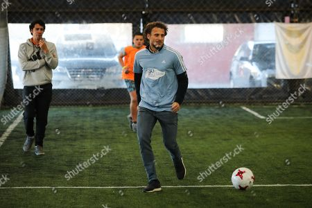 Former Uruguayan soccer player Diego Forlan (R) attends a celebration of the 30th anniversary of the NGO Gurises Unidos in Montevideo, Uruguay, 12 September 2019. Gurises Unidos was founded to protect the rights of disadvantaged children in Uruguay.