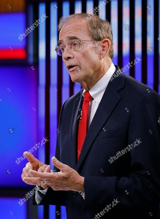 Republican Secretary of State Delbert Hosemann answers a question during a televised lieutenant governor debate between himself and Rep. Jay Hughes, D-Oxford, in Jackson, Miss