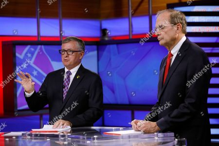 Delbert Hosemann, Jay Hughes. Rep. Jay Hughes, D-Oxford, left, answers a question while Republican Secretary of State Delbert Hosemann considers his response following their televised lieutenant governor debate in Jackson, Miss