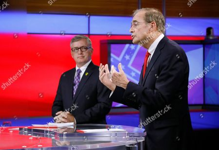 Delbert Hosemann, Jay Hughes. Rep. Jay Hughes, D-Oxford, left, listens as Republican Secretary of State Delbert Hosemann answers a question during their televised lieutenant governor debate in Jackson, Miss