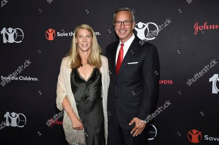 "Carolyn Miles, Peter Fasolo. Save the Children CEO Carolyn Miles, left, and Johnson & Johnson EVP Peter Fasolo attend the Save the Children's ""The Centennial Gala: Changing the World for Children"" at the Hammerstein Ballroom, in New York"