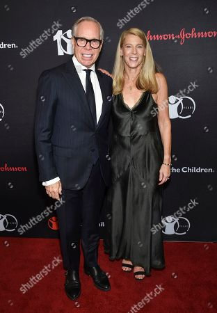 "Stock Picture of Tommy Hilfiger, Carolyn Miles. Humanitarian award honoree Tommy Hilfiger, left, poses with Save the Children CEO Carolyn Miles at the Save the Children's ""The Centennial Gala: Changing the World for Children"" at the Hammerstein Ballroom, in New York"