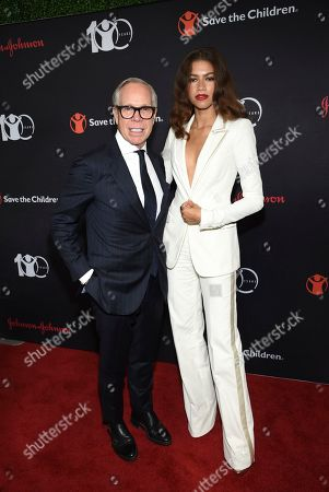 """Tommy Hilfiger, Zendaya Coleman. Humanitarian award honoree Tommy Hilfiger, left, and actress Zendaya Coleman attend the Save the Children's """"The Centennial Gala: Changing the World for Children"""" at the Hammerstein Ballroom, in New York"""