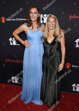 "Jennifer Garner, Carolyn Miles. Actress and Save the Children trustee Jennifer Garner, left, poses with Save the Children CEO Carolyn Miles at the Save the Children's ""The Centennial Gala: Changing the World for Children"" at the Hammerstein Ballroom, in New York"