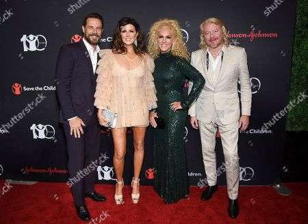 """Jimi Westbrook, Karen Fairchild, Kimberly Schlapman, Phillip Sweet. Little Big Town members, from left, Jimi Westbrook, Karen Fairchild, Kimberly Schlapman and Phillip Sweet attend the Save the Children's """"The Centennial Gala: Changing the World for Children"""" at the Hammerstein Ballroom, in New York"""