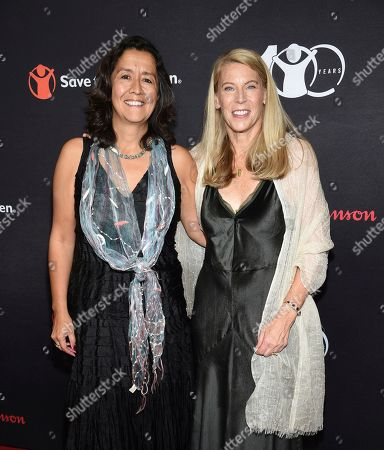 "Janti Soeripto, Carolyn Miles. Save the Children president and COO Janti Soeripto, left, and CEO Carolyn Miles pose together at the Save the Children's ""The Centennial Gala: Changing the World for Children"" at the Hammerstein Ballroom, in New York"