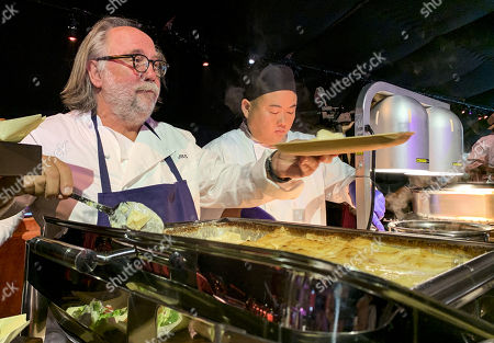 Chef and founder of Patina Restaurant Group Joachim Splichal (L) serves dishes during the 71st Emmy Awards Governors Ball press preview at L.A. Live in Los Angeles, California, USA, 12 September 2019. The 71st Primetime Emmy Awards will be held on 22 September 2019.