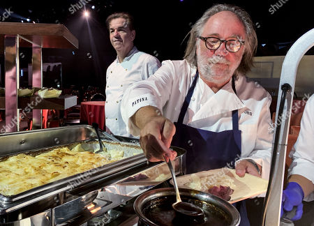 Stock Image of Chef and founder of Patina Restaurant Group Joachim Splichal (R) serves dishes during the 71st Emmy Awards Governors Ball press preview at L.A. Live in Los Angeles, California, USA, 12 September 2019. The 71st Primetime Emmy Awards will be held on 22 September 2019.