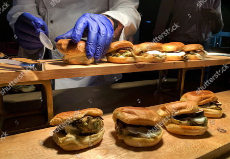 Stock Photo of A cook for Patina restaurant prepares sliders during the 71st Emmy Awards Governors Ball press preview at L.A. Live in Los Angeles, California, USA, 12 September 2019. The 71st Primetime Emmy Awards will be held on 22 September 2019.