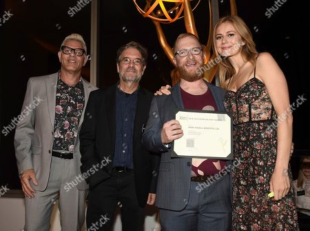 """Henry Russell Bergstein, Howard Meltzer, Peter Golden, Justine Lupe. Television Academy Governors Howard Meltzer, left, and Peter Golden, second from left, and Justine Lupe, right, pose with Henry Russell Bergstein, Emmy nominee for outstanding casting for a drama series for """"Succession,"""" at the Television Academy's Casting Directors Nominee Reception at 1 Hotel West Hollywood, in West Hollywood, Calif"""