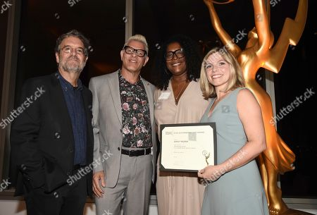 """Ashley Ingram, Leah Daniels Butler. Television Academy Governors Peter Golden, left, and Howard Meltzer, second from left, and Leah Daniels Butler, third from left, pose with Ashley Ingram, Emmy nominee for outstanding casting for a limited series, movie or special for """"When They See Us,"""" at the Television Academy's Casting Directors Nominee Reception at 1 Hotel West Hollywood, in West Hollywood, Calif"""