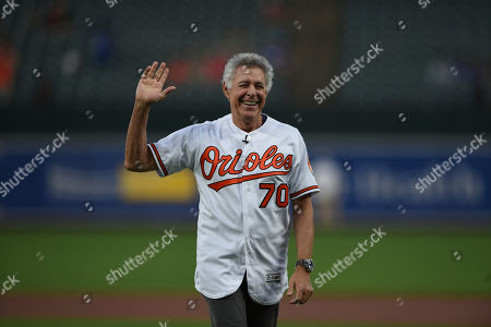 Actor Barry Williams, who played Greg Brady on the Brady Bunch waves to the crowd after throwing out the ceremonial first pitch before the Baltimore Orioles and Los Angeles Dodgers baseball game, in Baltimore