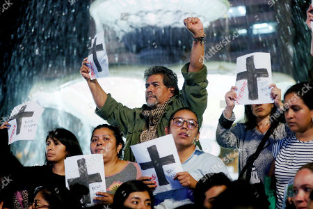 People take part in a protest against the Guatemalan President Jimmy Morales in the historical center of Guatemala City, Guatemala, 12 September 2019. Morales was attending an event at the National Palace of Culture when a group of demonstrators interupted, protesting against the removal of 41 crosses at a nearby square that comemorated the death 41 girls on 08 March 2017.