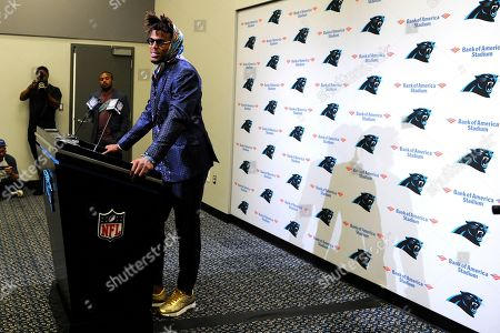 Stock Picture of Carolina Panthers quarterback Cam Newton speaks to members of the media following an NFL football game against the Tampa Bay Buccaneers in Charlotte, N.C