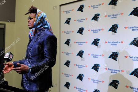 Carolina Panthers quarterback Cam Newton speaks to members of the media following an NFL football game against the Tampa Bay Buccaneers in Charlotte, N.C