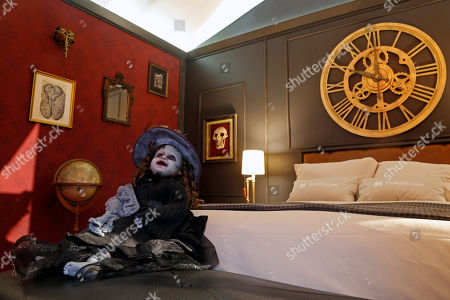 A doll sits in the 'Monster Suite' room in the city of Guadalajara, Jalisco, Mexico, 12 September 2019. The room is inspired by the works of Mexican director Guillermo del Toro.