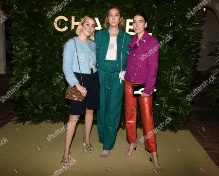 Alana Haim, Este Haim, Danielle Haim. Sisters Alana, left, Este, center, and Danielle Haim of the band HAIM pose together at the launch of the Gabrielle Chanel Essence fragrance at the Chateau Marmont, in Los Angeles