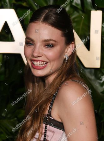 Kristine Froseth poses at the launch of the Gabrielle Chanel Essence fragrance at the Chateau Marmont, in Los Angeles