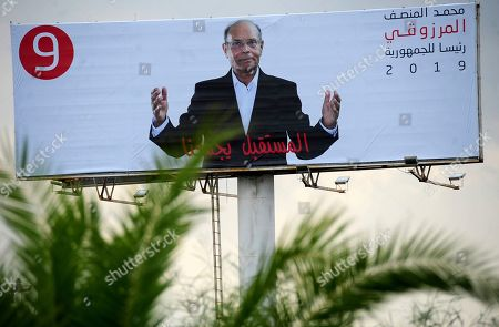 An electoral poster for presidential candidate Moncef Marzouki, a former human rights activist who was Tunisia's provisional leader after the Arab Spring revolution, in Tunis. Twenty-six candidates are running for president of Tunisia in a cacophonous election seen as key to securing the country's young democracy. The first-round presidential vote is being held