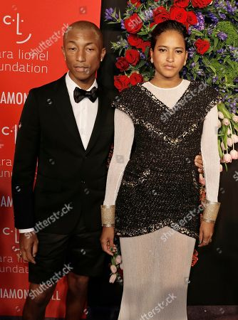 Stock Picture of US rapper, singer, songwriter Pharrell Williams (L) and his wife Helen Lasichanh (R) attend Rihanna's 5th Annual Diamond Ball, benefiting the Clara Lionel Foundation, at Cipriani Wall Street in New York, New York, USA, 12 September 2019.