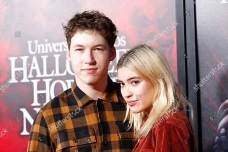 Stock Picture of US film and television actor Devin Druid and Lauren Eggleton at the opening celebration for Halloween Horror Nights at Universal Studios Hollywood in Los Angeles, California, USA 12 September 2019.
